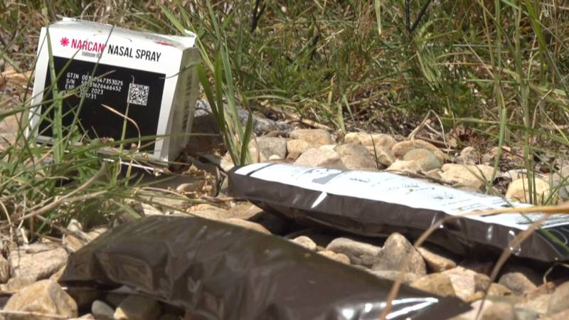 A Narcan box and other debris found on the ground.
