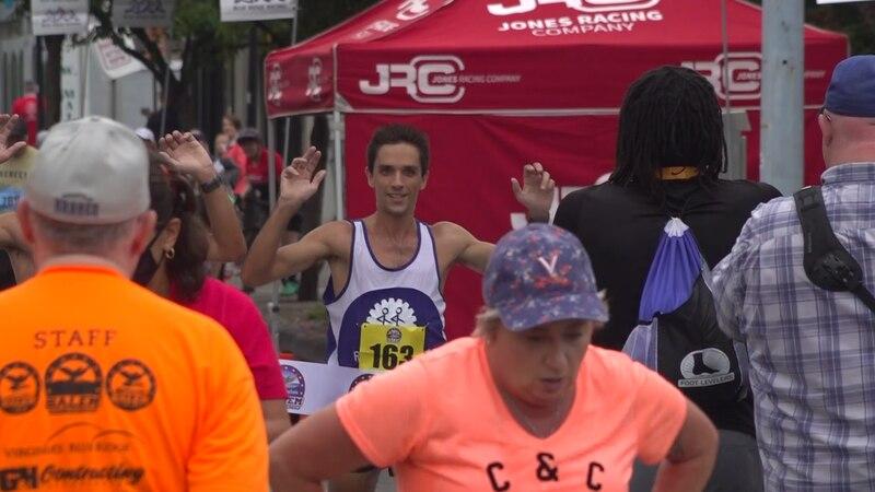 Jacob Coccia crossing the finish line at the 6th annual Salem Half Marathon on Saturday....