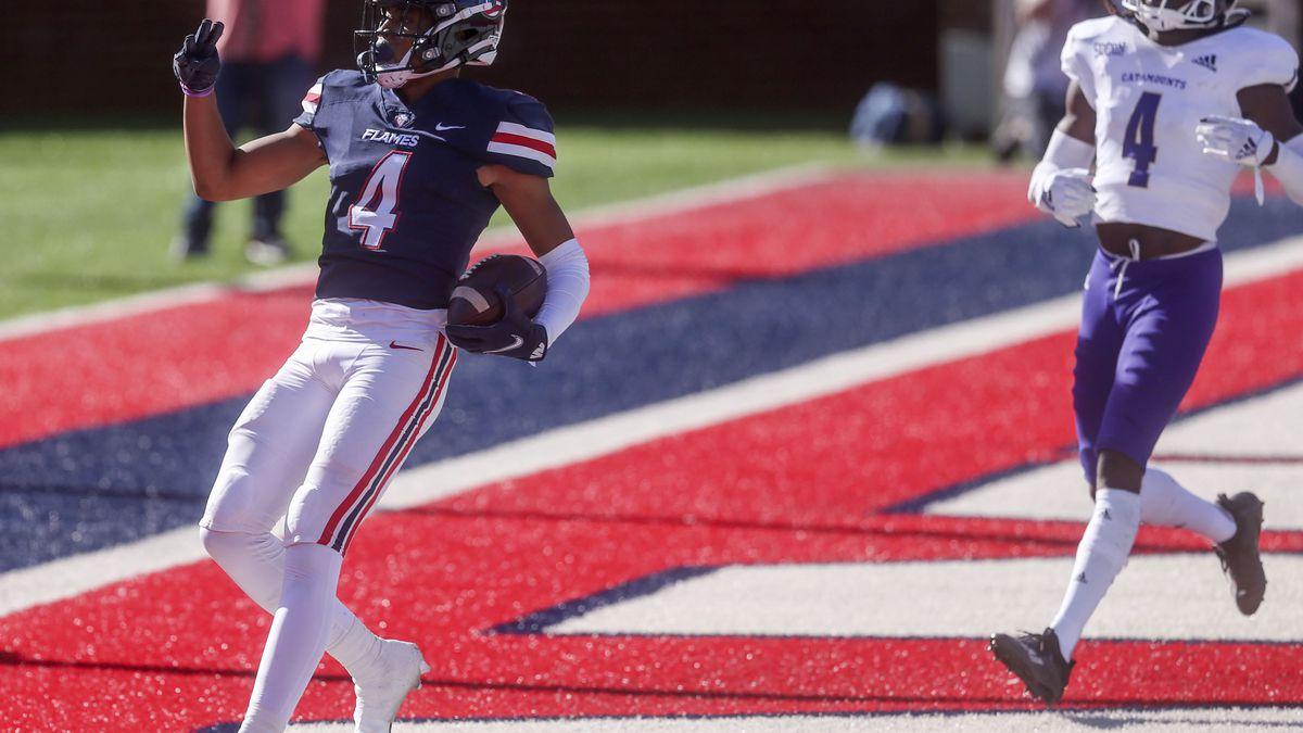 Liberty wide receiver CJ Daniels (4) scores a touchdown past Western Carolina  Safety A.J....