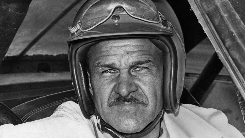 FILE - In this Aug. 1, 1969, file photo, Wendell Scott sits in a race car, location not known....
