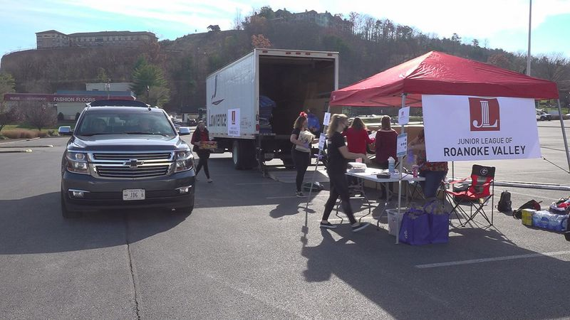 Junior League members set up a drive-thru toy drive at Tanglewood Mall.