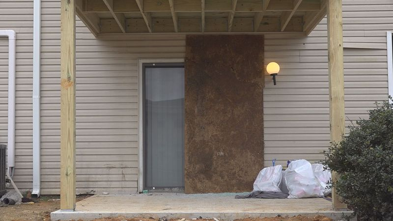 A door was boarded up at the Copper Beach Apartments in Radford where one of the two overnight...