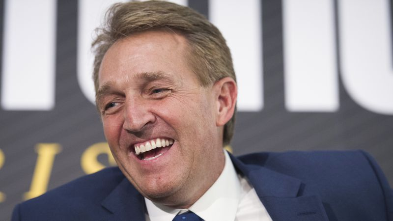 FILE - In this Oct. 2, 2018 file photo, then-Sen. Jeff Flake, R-Ariz. participates in an...