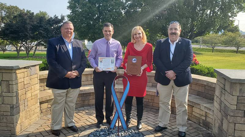 WDBJ7's Leo Hirsbrunner and Kimberly McBroom receive the Adam Ward Media Excellence Award