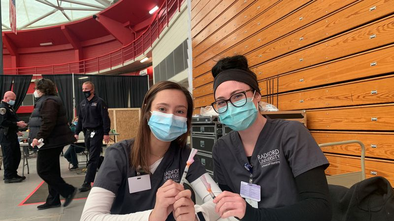 Nursing students at Radford University are volunteering their time to help administer COVID-19...