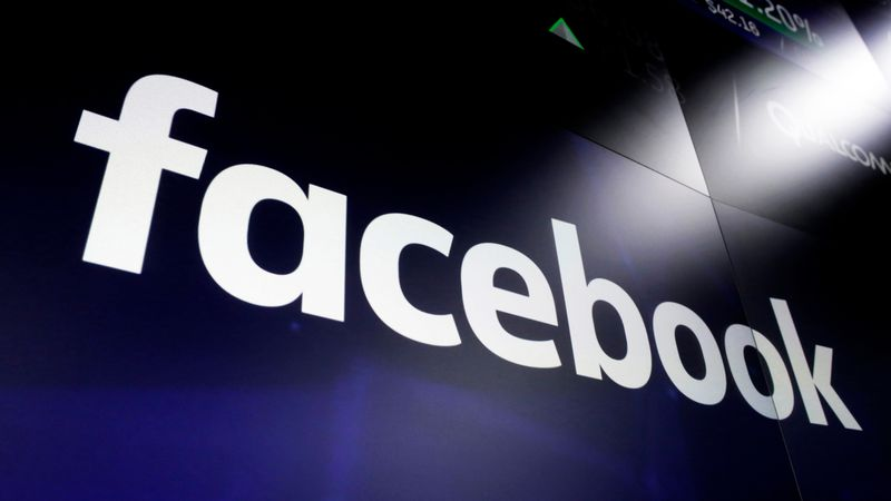 FILE - This March 29, 2018 file photo shows the Facebook logo on screens at the Nasdaq...