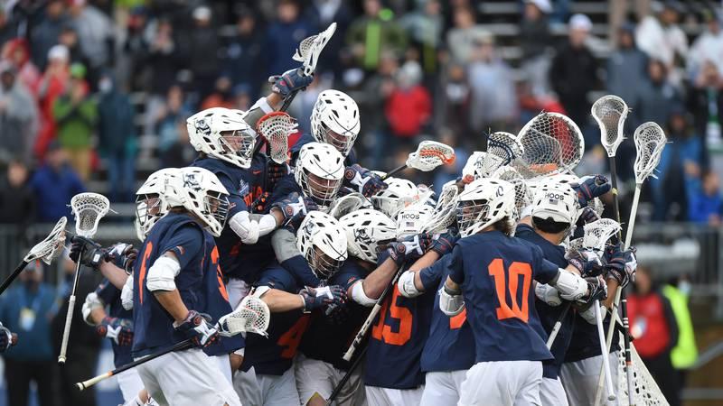 The UVA men's lacrosse team celebrates its 7th national championship.