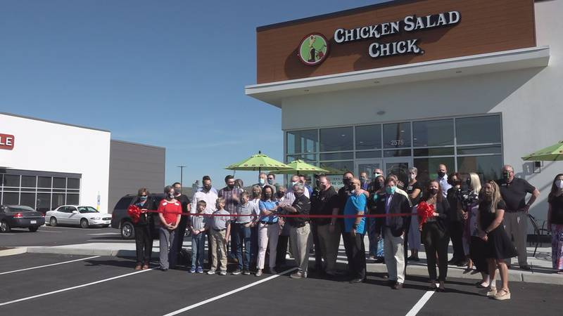 Franchise owners, local leaders and the Montgomery County Chamber Commerce prepare to cut the...