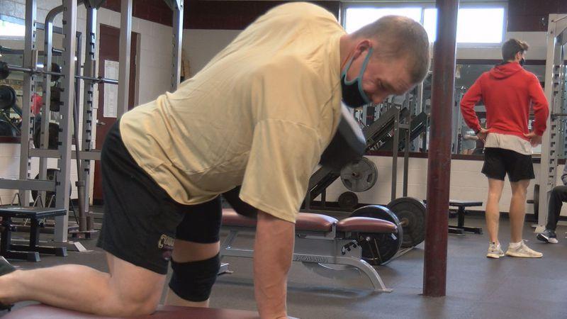 Senior linebacker and running back William Bishop lifts weights at a workout at Pulaski County...