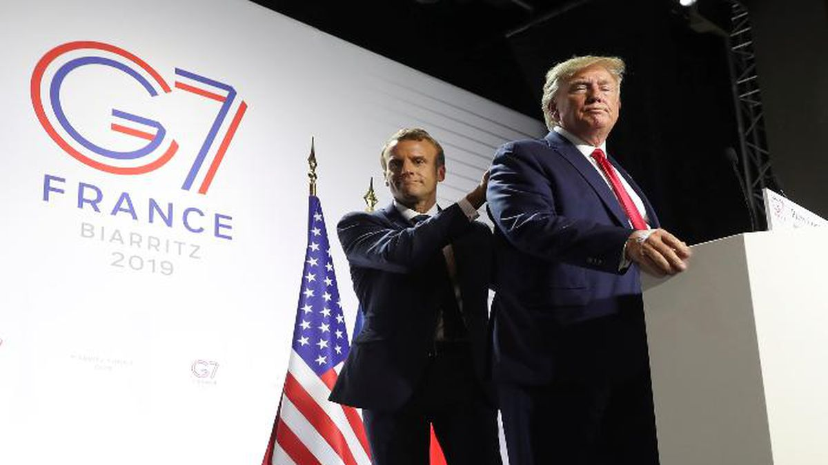 President Donald Trump and French President Emmanuel Macron wrap up a joint press conference at the G-7 summit in Biarritz, France, Monday, Aug. 26, 2019. (AP Photo/Andrew Harnik)
