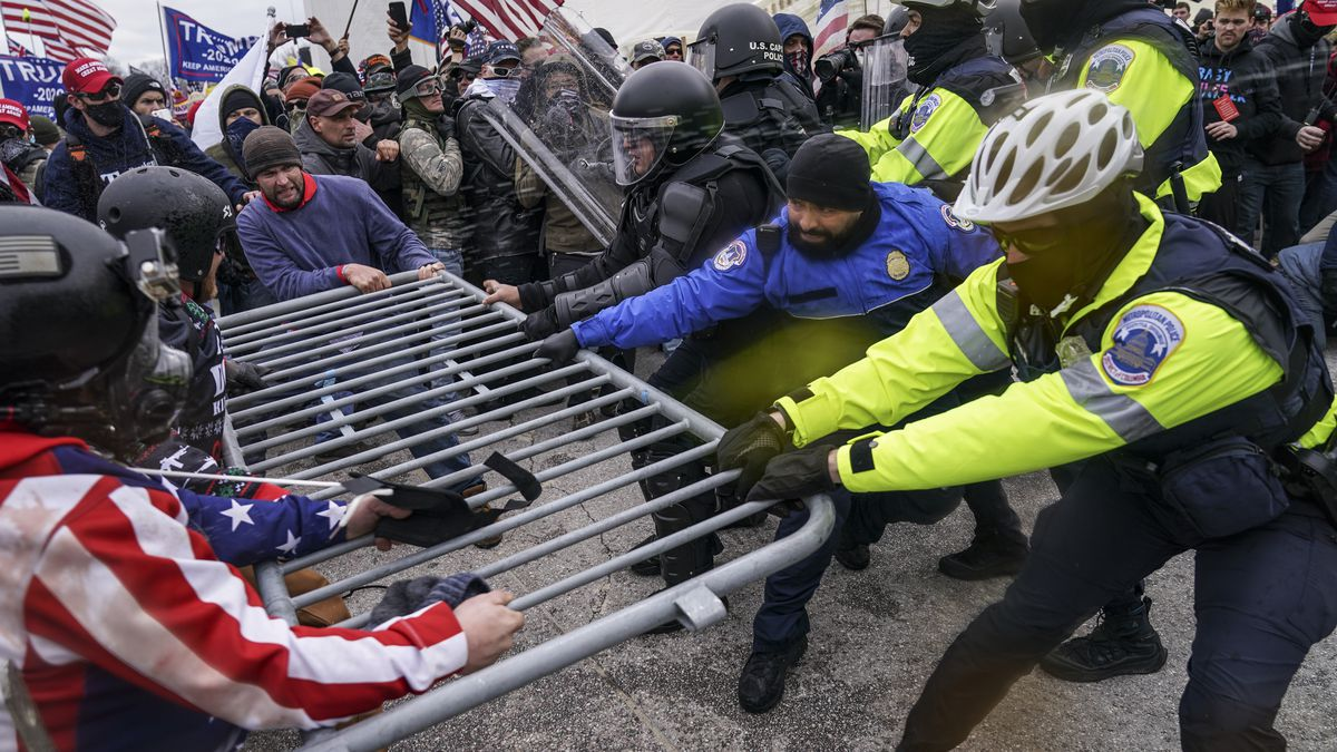 FILE - In this file photo from Wednesday Jan. 6, 2021, Trump supporters beset a police barrier...