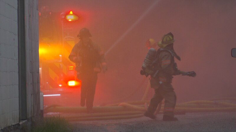 Crews fought through heavy rain and smoke to put out the fire.