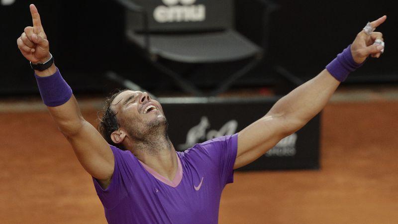 Spain's Rafael Nadal celebrates after defeating Serbia's Novak Djokovic at their final match of...