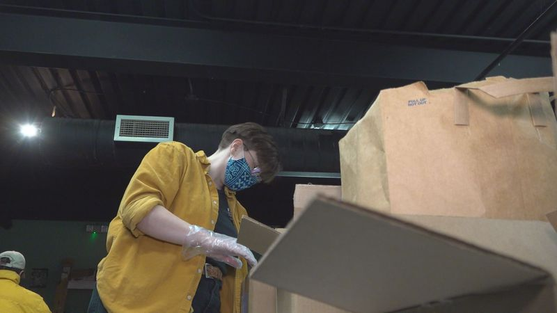 Twice a week volunteers from the Future Economy Collective fill boxes with food, clothing and...