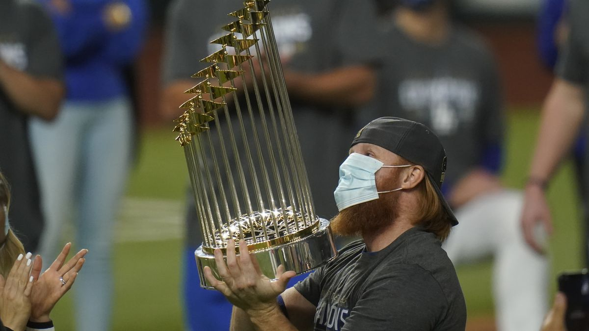 Los Angeles Dodgers third baseman Justin Turner celebrates with the trophy after defeating the...