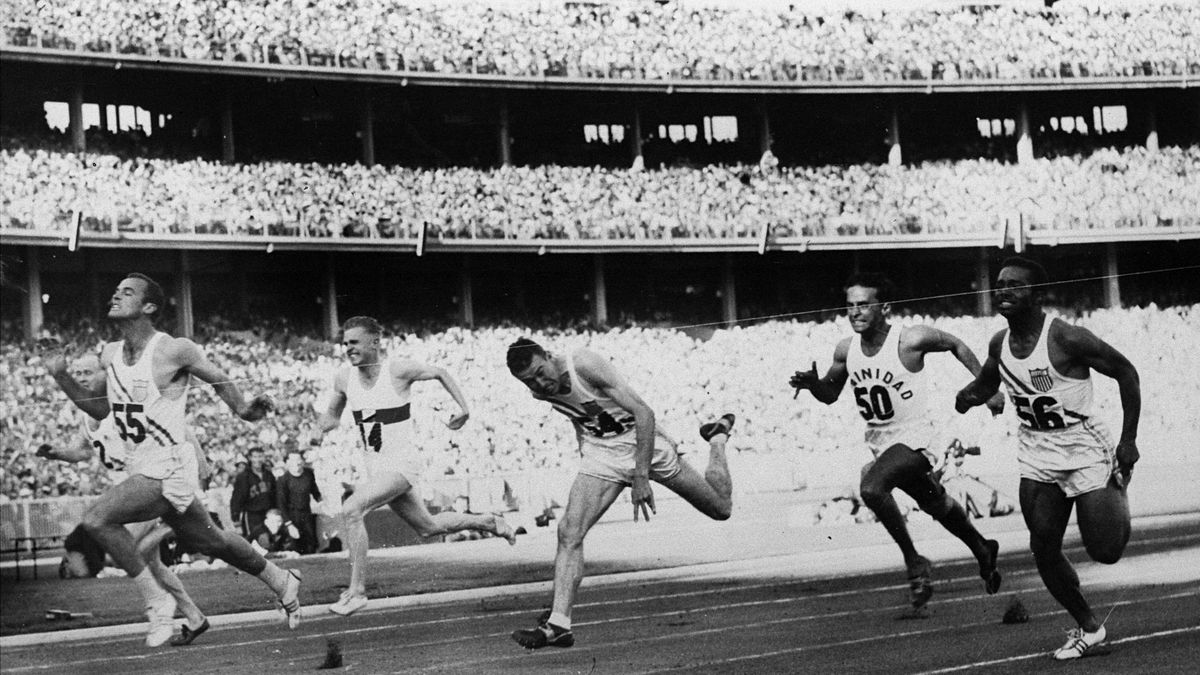 FILE - In this Nov. 23, 1956, file photo, United States' Bobby Joe Morrow (55) crosses the finish line of the men's 100-meter race in 10.5 seconds, equaling an Olympic record, during the Summer Olympics in Melbourne, Australia. Morrow, the Texas sprinter who won three gold medals in the 1956 Melbourne Olympics while a student at Abilene Christian University, died Saturday, May 30, 2020. He was 84. (AP Photo/File)