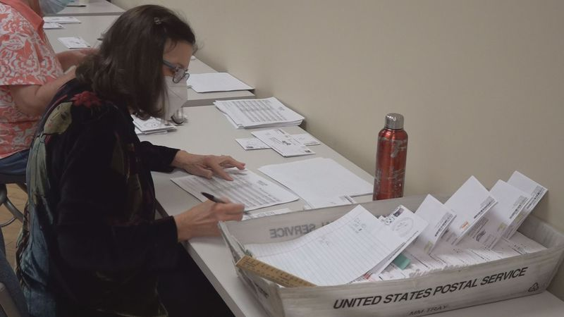 Election workers pre-process absentee ballots ahead of the election to keep up with the demand.