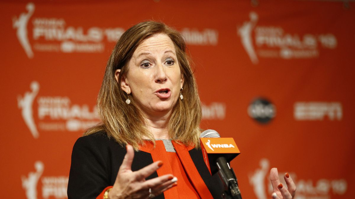 "FILE - In this Sept. 29, 2019, file photo, WNBA Commissioner Cathy Engelbert speaks at a news conference before Game 1 of basketball's WNBA Finals between the Connecticut Sun and the Washington Mystics, in Washington. The WNBA has announced plans to play a reduced season, with a 22-game schedule that would begin in late July without fans in attendance. ""There's a lot to do between now and the tip of the season, now that we've selected IMG Academy"" as the location to play, WNBA Commissioner Cathy Engelbert said in a phone interview Monday, June 15, 2020.  (AP Photo/Patrick Semansky, File)"