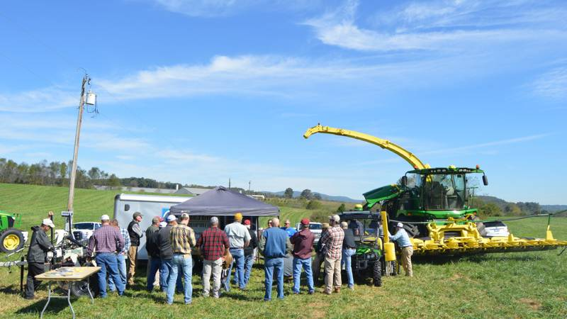 A group looking at equipment showcased at Kentland Farm Field Day.