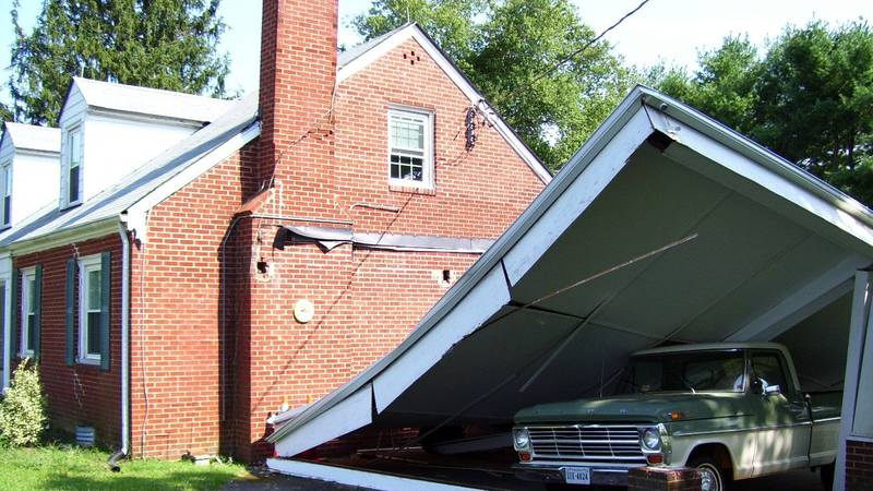 A carport left damaged beside a home from the 2011 earthquake.