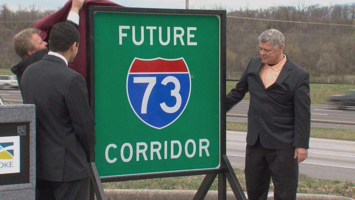 """Members of Roanoke City Council unveil a """"Future 73"""" sign along Interstate..."""
