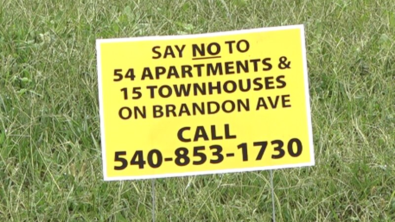 These signs have been placed all over the area near the 7.56 acres that are set to be developed...