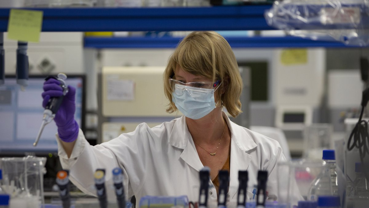 A lab technician works during research on coronavirus, COVID-19, at Johnson & Johnson...